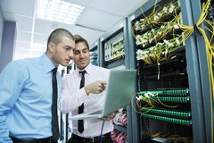 It engineers in network server room stock photos
