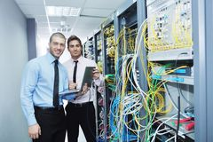 It engineers in network server room Royalty Free Stock Image