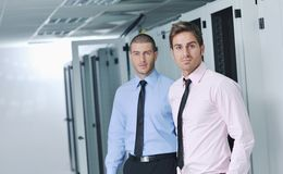 It engineers in network server room Royalty Free Stock Photo