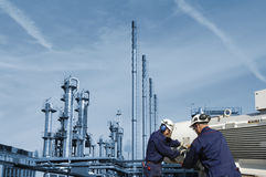 Engineers with oil and gas machinery