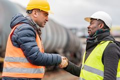 Engineers reaching an agreement stock photo
