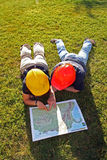 Engineers reading a map. Grass Royalty Free Stock Photo