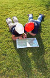 Engineers reading a map. On the grass Royalty Free Stock Images