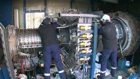 Engineers Repairing a Gas Turbine