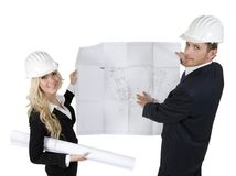 Engineers reviewing blueprint Stock Image