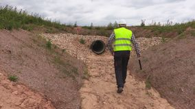 Engineers shaking hands at the drainage ditch