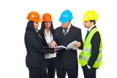Engineers team examine their blueprints royalty free stock images