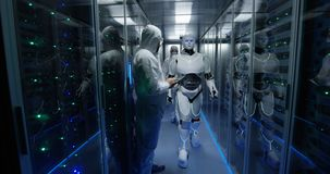 Engineers testing on robot controls inside the laboratory stock photos