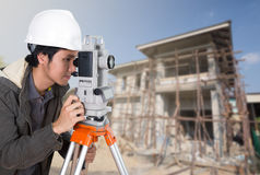 Engineers use tacheometer or theodolite with building constructi Stock Photos