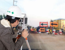 Engineers use tacheometer or theodolite with construction road w Stock Photography