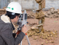 Engineers use tacheometer or theodolite with construction site Royalty Free Stock Images