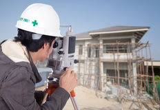 Engineers use tacheometer or theodolite with house construction Stock Photography