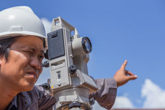 Engineers use tacheometer or theodolite for survey line columns Royalty Free Stock Photos