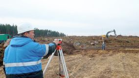 Engineers use tacheometer or theodolite for survey line columns for control of new lands stock footage