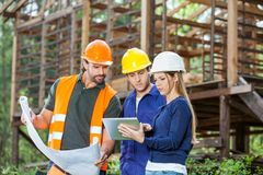 Engineers Using Digital Tablet At Construction Stock Image