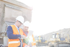 Engineers using laptop at construction site against clear sky Royalty Free Stock Photos