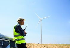 Engineers and wind turbines. Engineers and wind turbines and electricity Royalty Free Stock Image