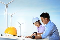 Engineers and wind turbines. Engineers and wind turbines and electricity Stock Images