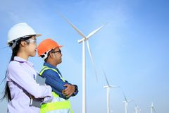 Engineers and wind turbines. Engineers and wind turbines and electricity Stock Photography