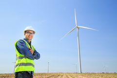 Engineers and wind turbines. Engineers and wind turbines for electricity production stock images