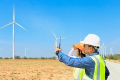 Engineers and wind turbines. Engineers and wind turbines for electricity production stock photo