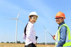 Engineers and wind turbines. Engineers and wind turbines for electricity production royalty free stock photo