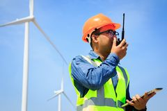 Engineers and wind turbines. Engineers and wind turbines for electricity production royalty free stock images