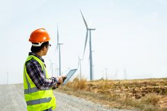Engineers and wind turbines. Engineers and wind turbines and electricity Royalty Free Stock Images