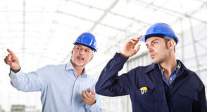 Engineers at work. In a construction site Royalty Free Stock Photos