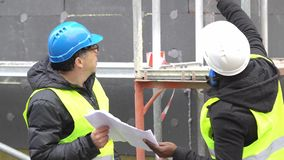 Engineers at work on construction site stock footage