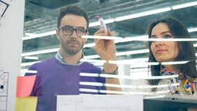 Engineers work with a desk, discussing plan, office workers. 4K stock footage