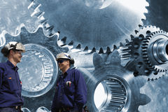 Engineers, workers with cog and gear machinery Royalty Free Stock Photography