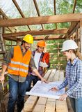 Engineers Working On Blueprint In Incomplete Royalty Free Stock Image