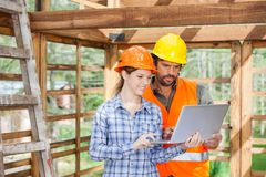 Engineers Working On Laptop At Construction Site Stock Photography