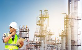 Engineers working in refineries. Engineers working in oil refinery Royalty Free Stock Images