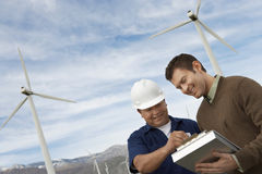 Engineers Working At Wind Farm Stock Image
