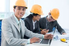 Engineers at workplace Stock Photography