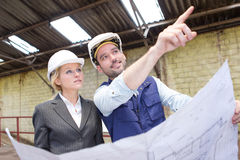 Enginneer and worker working on a brownfield royalty free stock image