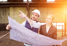 Enginneer and worker working on a brownfield stock images