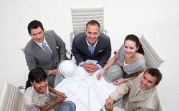 Enginners studying plans in the office Stock Photo