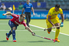 England Beats India at the World Cup Hockey 2014. THE HAGUE, NETHERLANDS - JUNE 2: Englishman Catlin reaches for the ball to stop a rush by Indian player stock photos