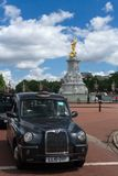 England cars ans statue royalty free stock image
