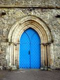 England: Cartmel Priory church blue door Stock Photo