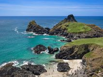 People on beach at Kynance Cove, Cornwall, UK royalty free stock photography