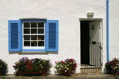 UK, Cornwall, St Mawes. England, Cornwall, St Mawes, Blue and white cornish seaside cottage royalty free stock photography