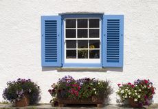 England, Cornwall, St Mawes. Europe, England, Cornwall, St Mawes, Blue and white cornish seaside cottage shuttered window royalty free stock images
