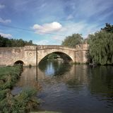 England, Cotswolds, Lechlade. England, Cotswolds, Gloucestershire, Lechlade, historic Halfpenny Bridge over the River Thames Stock Photography