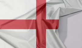 England fabric flag crepe and crease with white space. England fabric flag crepe and crease with white space, red centred cross on a white background royalty free stock photos