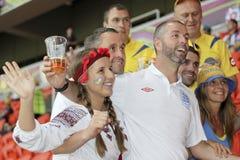 England fan between the Ukrainian fans. DONETSK, UKRAINE - JUNE 19, 2012: England fan between the Ukrainian fans before the match of EURO 2012 Ukraine vs Stock Photography