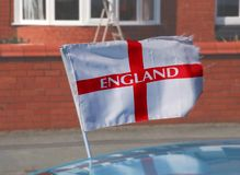 England Flag. Flag of Saint George attached to a car blowing in the wind in readiness for the world cup Royalty Free Stock Photo